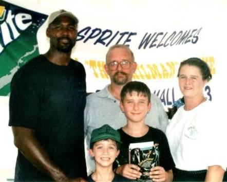 We met Karl Malone!  (Clockwise from left to right:  Karl Malone, John, Lee Ann, Johnny & Patrick Hamm)
